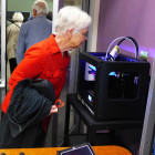 Sabra examines 3-D printer